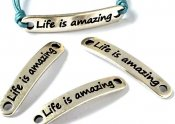 "Metalldel ""Life is amazing"" Silverfärg 38x6,5mm 1st"